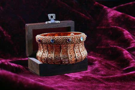 big gold hand bracelet