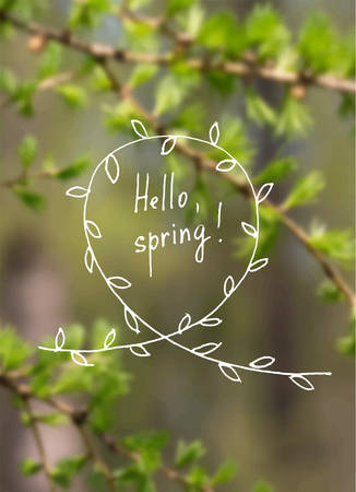 Hand drawn branch with leaves and typography on blurry green trees in a forest background - Hello, spring. Vector illustration EPS10