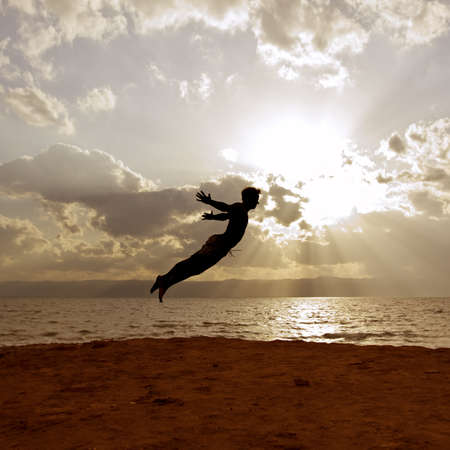 flying man: One person acrobatic jumping scene, look like Peter Pan is flying, symbolize vitality, aspiration, success, progress as well as fantasy, imagination, incentive, personal development, power, Agility and much more…Scene is performed in front of the dead sea