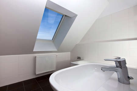 skylights: Real photo of a modern bath room of a city-flat with skylight window