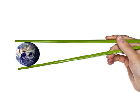 origin: blue planet earth between green chopsticks - Elements of this image furnished  Stock Photo
