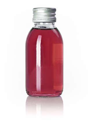 linctus: Bottle of red liquid isolated over white background Stock Photo