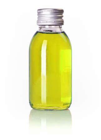 linctus: Bottle of yellow liquid isolated over white background Stock Photo