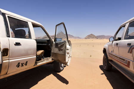Wadi: Trip with some damn old off-road vehicle through the desert  Stock Photo