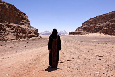burka: Nomadic woman with burka in the desert