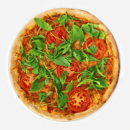Pizza Margharita with arugula and slices of tomato Stock Photo