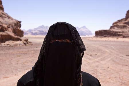 Portrait of Bedouin woman with burka in desert Stock Photo - 20823716