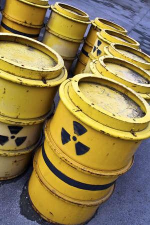 radioactive warning symbol on yellow tuns of toxic waste photo
