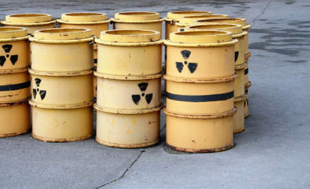 Rusty and old barrel with radioactive waste photo