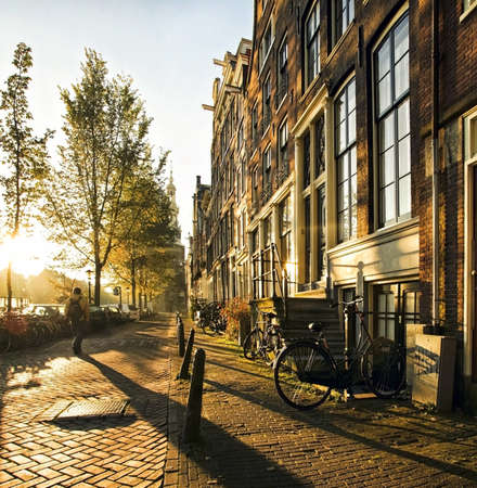 Wonderful and idyllic street scene at sunset in amsterdam