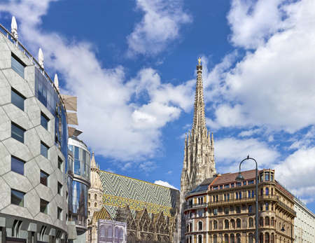 cultural history: The Vienna Stephansdom with the so called Haas-Haus opposite on a sunny day at the all time well-frequented Stephansplatz  The Stephansplatz is a square at the geographical centre of Vienna