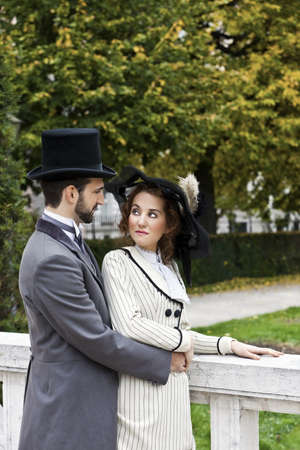 A loving couple, dressed in the style in the end of the 19th century, in the park  Stock Photo