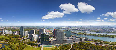 famous industries: Very clear and detailed panorama of the amazing Skyline of Donau City Vienna with the famous UNO City at the left the Danube at the right and the Donaupark in front The image was made out of several high resolution vertical shots meticulously merged into