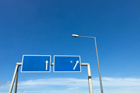 cleared road sign above motorway exit photo