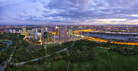 Panorama of the amazing Skyline of Donau City Vienna with the famous UNO City at the left the Danube at the right and the Donaupark in front  Stock Photo - 21610303