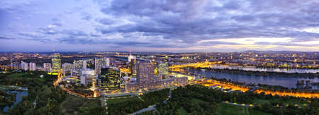 Panorama of the amazing Skyline of Donau City Vienna with the famous UNO City at the left the Danube at the right and the Donaupark in front