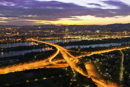 the danube: Panorama of Vienna with Danube River   Island  Donauinsel , highway junction at night