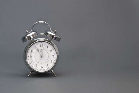 running out of time: Time is running out fast   Alarm clock shows the highest time with copy space on the right  Stock Photo