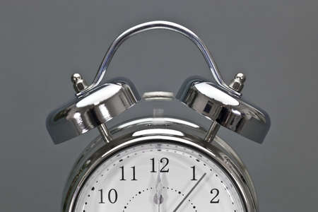 time out: Time is running out fast   Alarm clock shows the time just seconds past 12 o Stock Photo