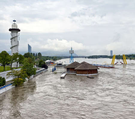 occurs: Flood disaster at the Danube and Danube Island  german Donauinsel , an extensive public recreation area of Vienna  Such a flood occurs only once every 100 years  Editorial