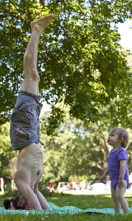 prototypical: son is wondering at his father practicing yoga