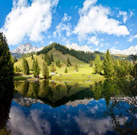 Little alpine lake at the Dachstein mountains in Filzmoos - Austria photo