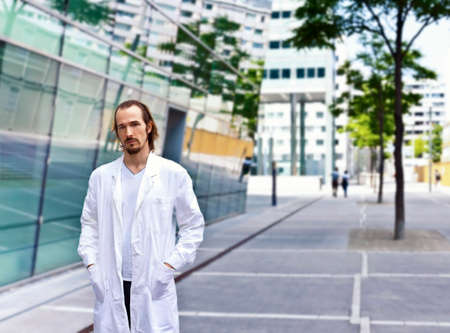 biophysics: Young Scientist doctor with confident personality standing in urban area