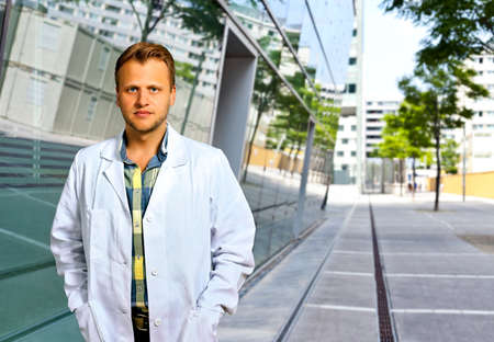 biophysics: Young Scientist or doctor with confident personality standing in urban area
