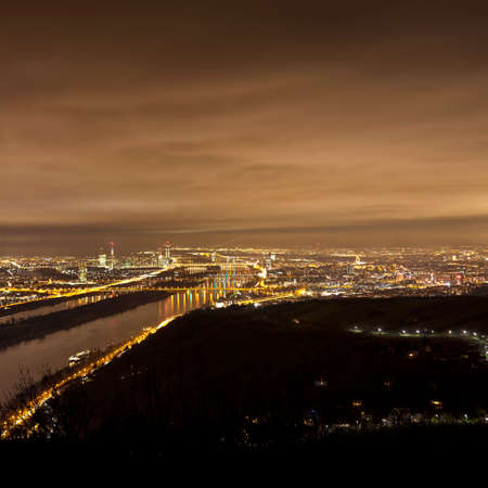 Skyline of Vienna and Danube at night - Viewpoint Leopoldsberg