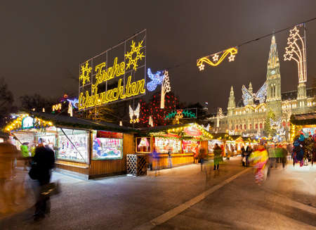 Vienna Town Hall and the traditional Christmas  Market at night