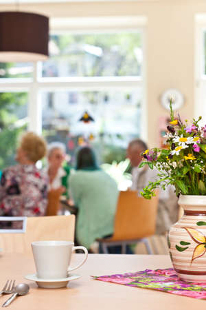 community health care: Senior Community in a retirement home having breakfast Stock Photo