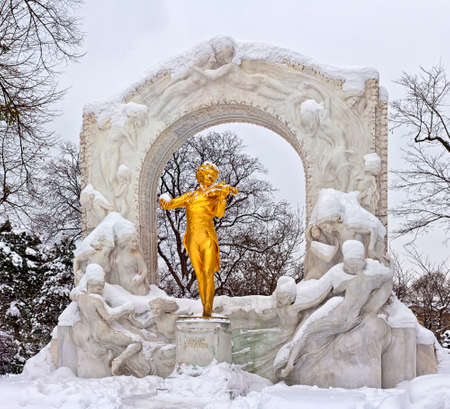 Statue of Johann Strauss in winter in Vienna Stadtpark