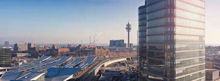 The new Main Railway Station of Vienna - Austria. Located in the Favoriten, the 10th district of Vienna with the new Headquarter of the Austrian Federal Railways and Radio tower and the historic Arsenal (former military complex) in the background.