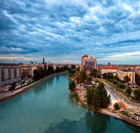 Vienna Danube Canal and the Herrmann beach bar at dusk 스톡 콘텐츠