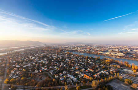 Vienna and its Danube River with the Brigittenauer Bridge and one of the most interesting extensive public recreation area of Vienna called Danube Island as seen from the Danube Tower. Mountains in the back are Leopoldsberg and Kahlenberg. Stock Photo