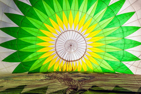 Inside a green and white patterned hot air balloon in preparation Stock Photo