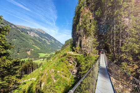 Swing bridge over the Riesach waterfall at Rohrmoos Untertal. The waterfall is the highest of Styria Austria