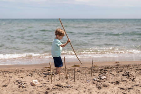 Boy playing at the beach. Scene looks like from the famous movie Lords of the flys.