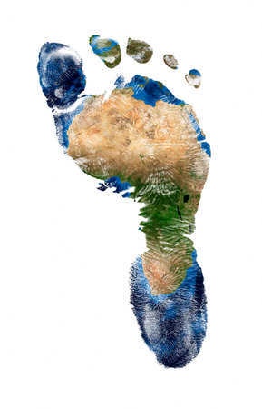 Real imprint of child foot with a world map of africa - isolated on white background.