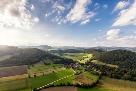 Aerial Shot of picturesque landscape of the Vienna Woods in Lower Austria with little village Untermeierhof