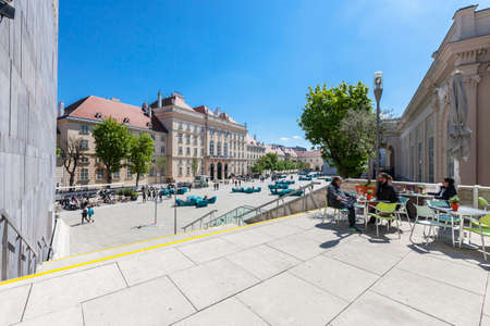 VIENNA, AUSTRIA - APRIL 29, 2016: Many people enjoy a sunny afternoon at the Museumsquartier in Vienna. It is the eighth largest cultural area in the world. Stock Photo - 119558997