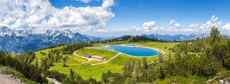 View from the mountain top called Hoess at the Austrian Alps. The Hoes is part of the Village Hinterstoder in Upper Austria and especially known for his famous world cup ski races in winter. Stock Photo