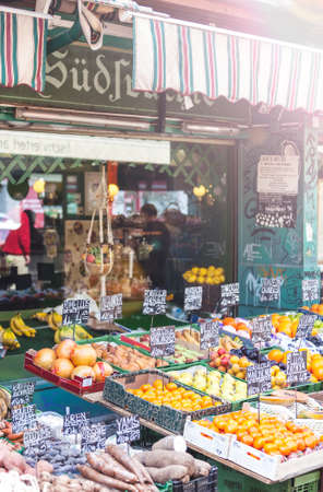 One of many small shops at the market Naschmarkt in Vienna with tropical and exotic fruits. The popular Naschmarkt has existed since the 16th century, is one of the oldest markets in Europe and 1.5km long.