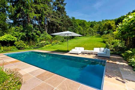 Modern swimming pool in the garden.