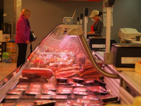 meat counter: Display of a butcher seen from the side