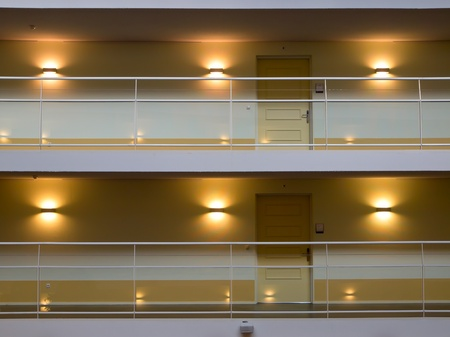 metal handrail: A balustrade balcony with doors in a new modern urban building Stock Photo