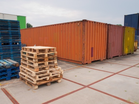 merchandize: containers and pallets waiting on a  trading site