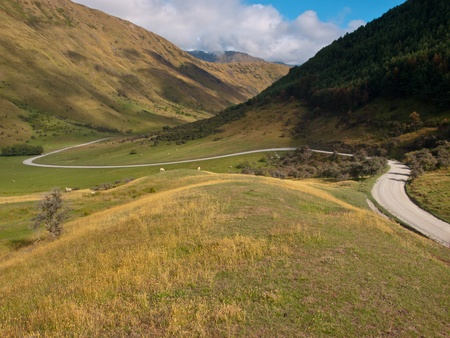 a perfect winding road through the hills Stock Photo - 10834431