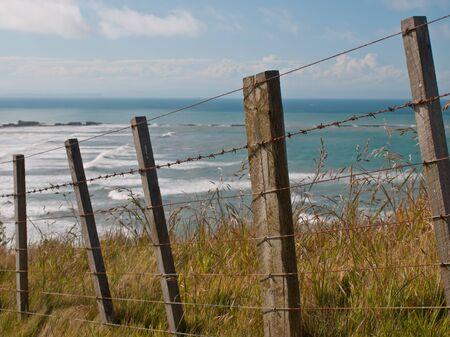 stockade: An oceanview behind a batten fence