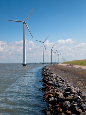 Row of wind turbines along the coast photo